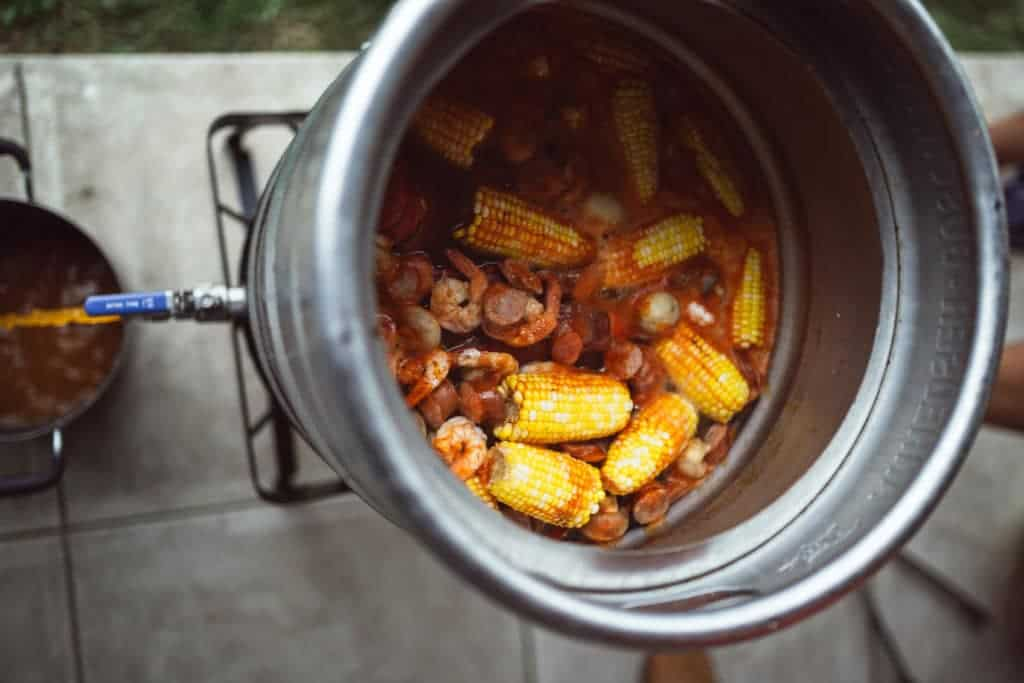 Large Stock Pot draining water for low country shrimp boil