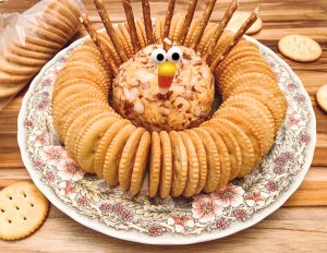 Turkey cheese ball on platter with crackers