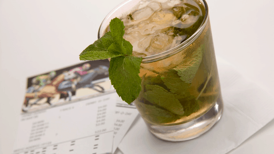 Mint julep and betting tickets for Kentucky Derby