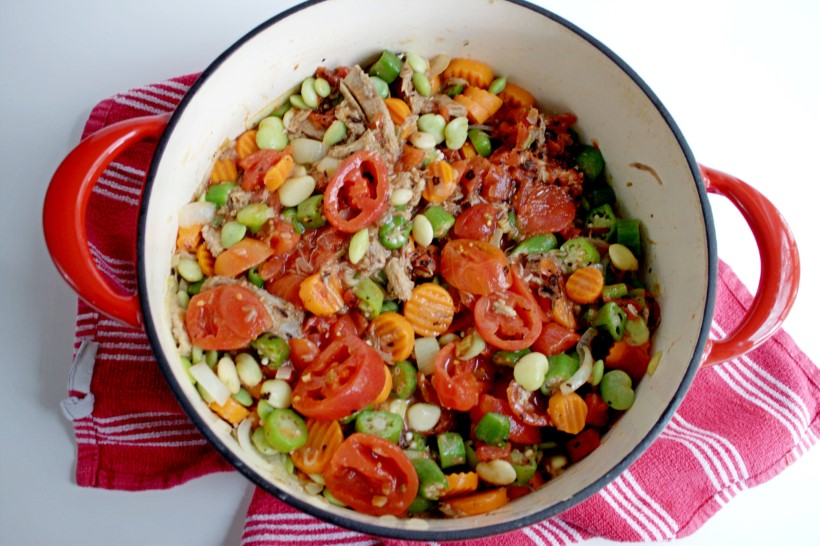 Frozen veggies and tomatoes in dutch oven