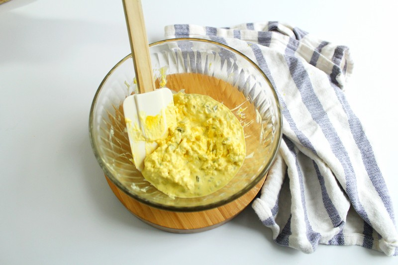 deviled egg filling in bowl with spoon