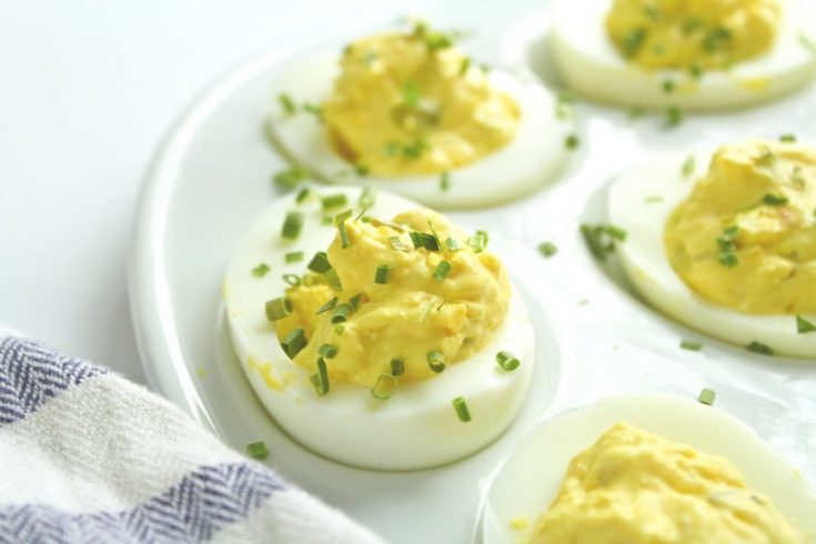 deviled eggs garnished with chives upclose