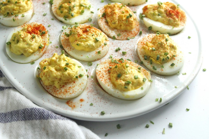 deviled eggs with chives and paprika