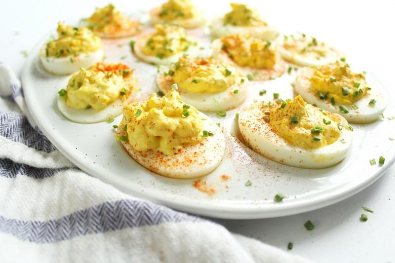 deviled eggs with paprika and chives