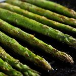 Roasted asparagus on pan, close-up