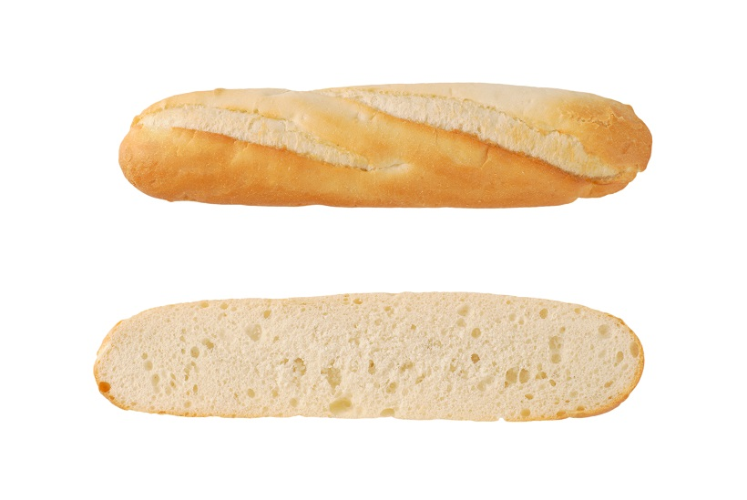 halved french baguette on white background