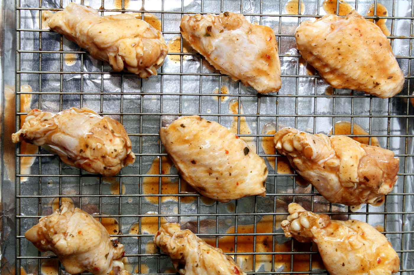 Chicken wings on baking sheet with foil
