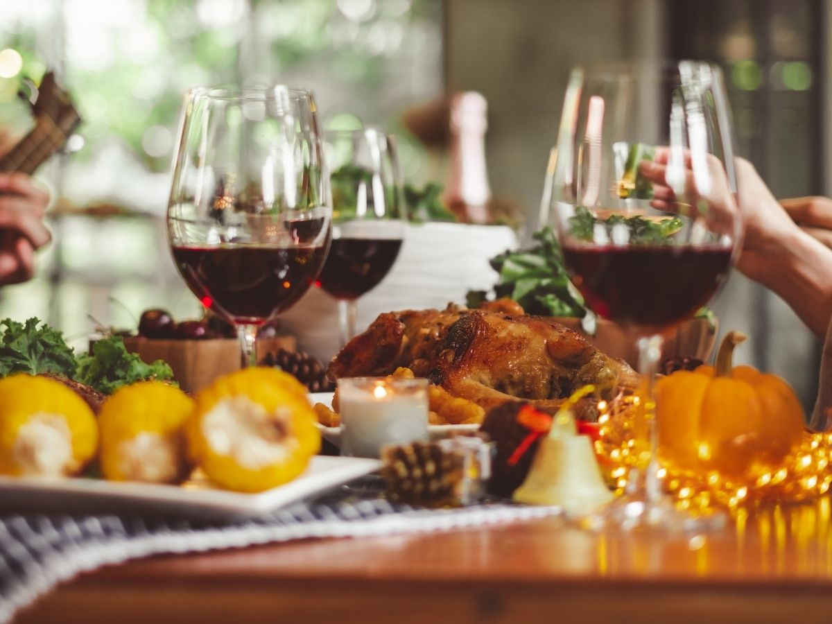 table setting with wine glasses and red wine