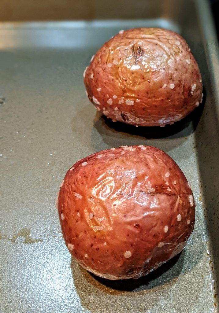 roasted whole red potatoes on baking sheet
