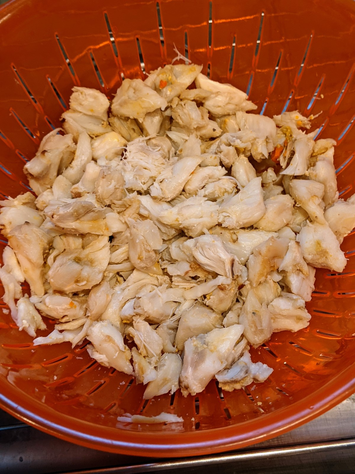 lump crab meat draining in collander