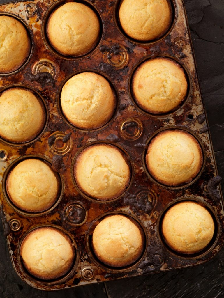 Dark muffin tin of corn muffins