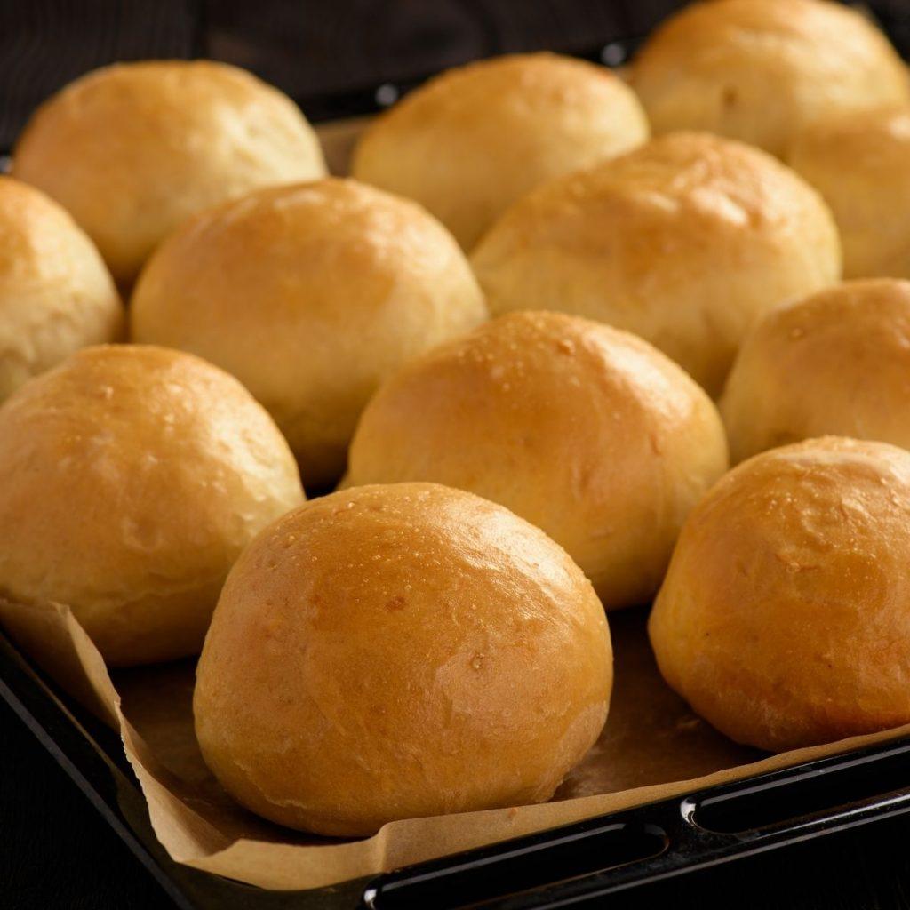 Prepared potato rolls on baking sheet