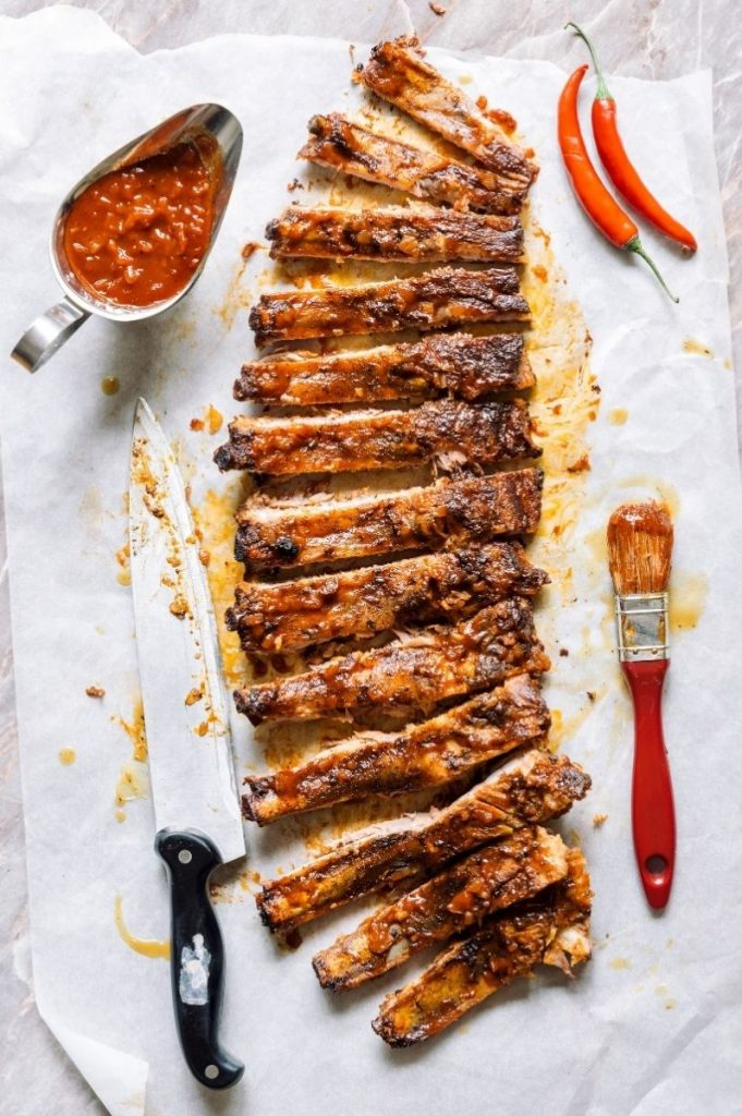 bbq ribs with basting brush vertical shot