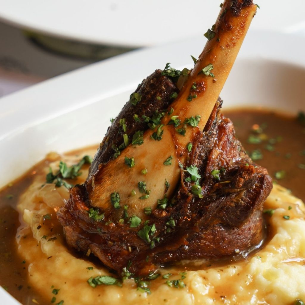 lamb shank over mashed potatoes with dark brown gravy
