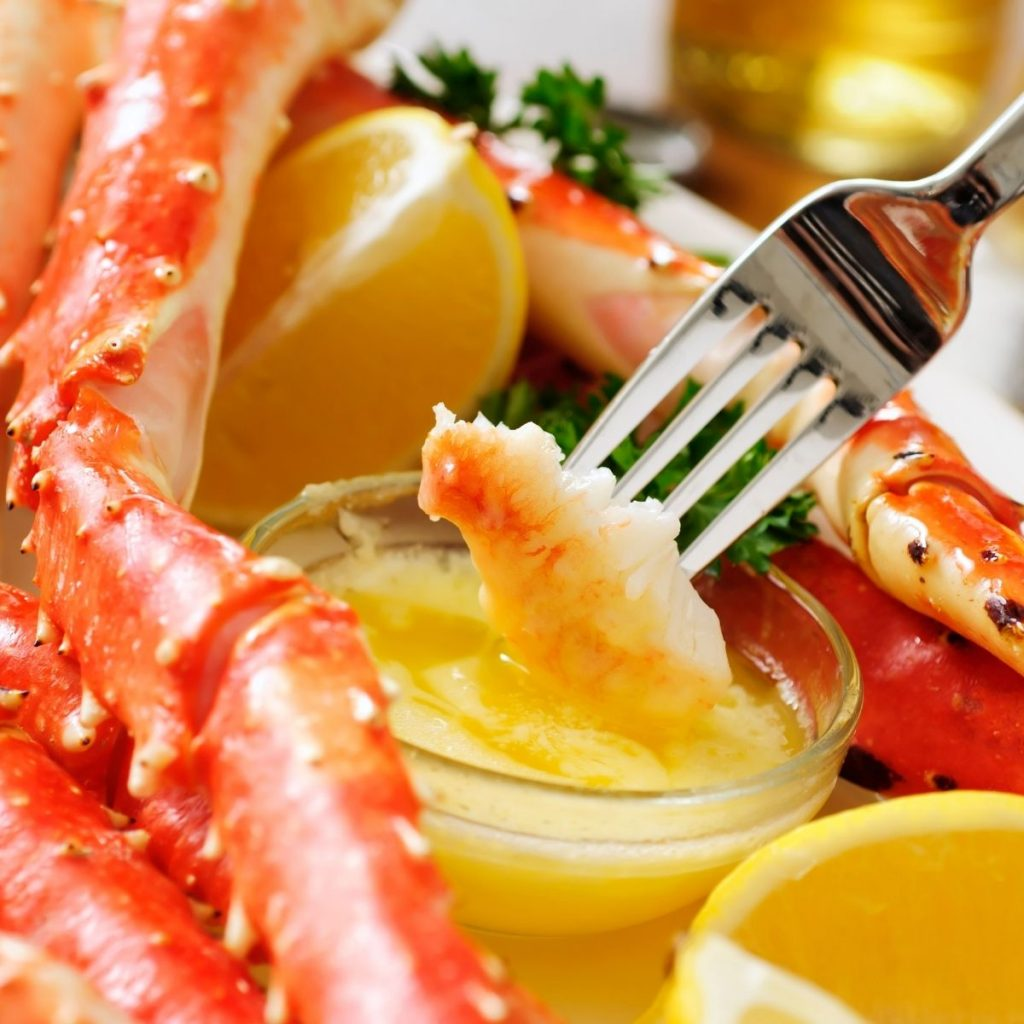 Dipping crab meat into melted butter