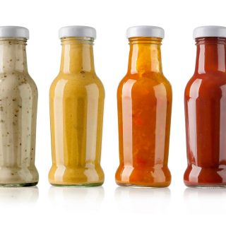 row of different bbq sauces in bottles