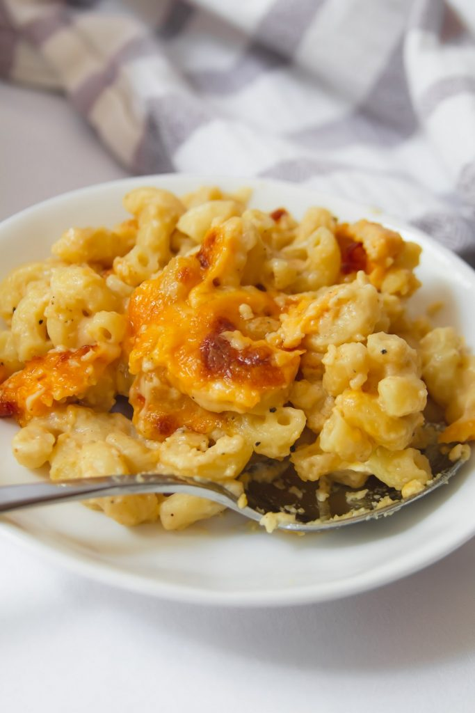 mac and cheese on a plate with spoon