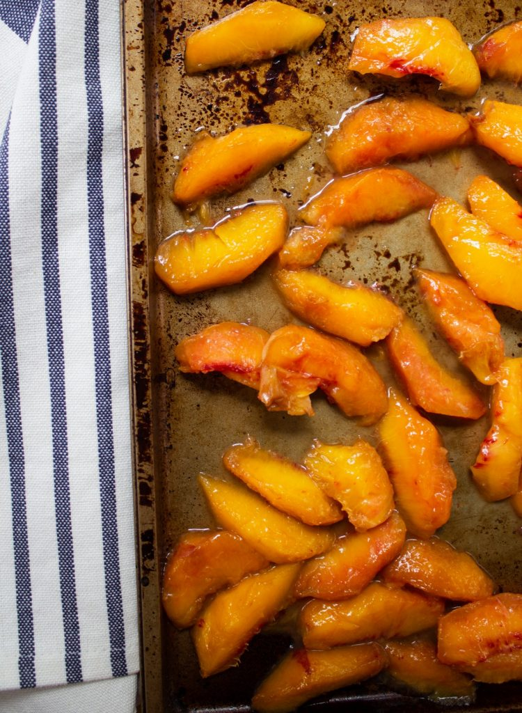 baking sheet of peeled fresh peaches