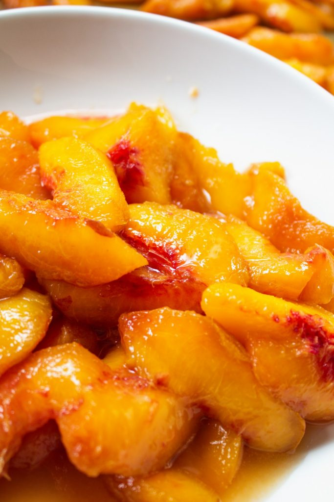 Peeled peaches in a white bowl